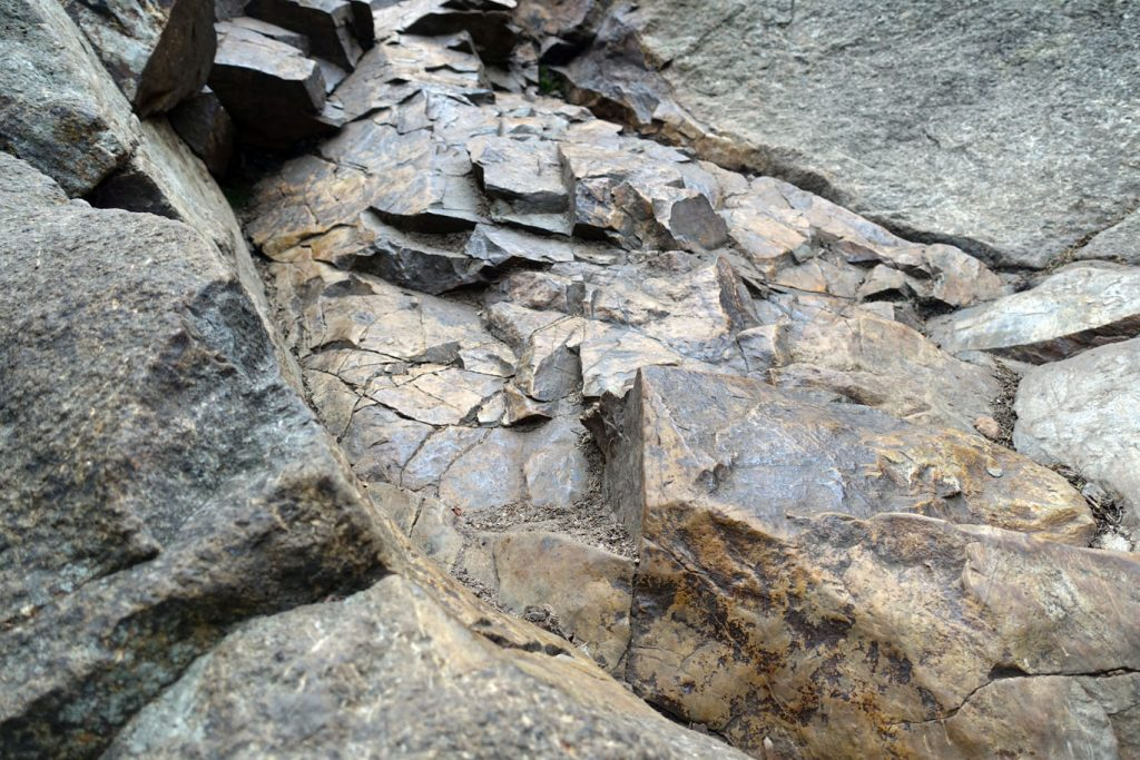 Slippery brown rock. Treacherous in the rain.